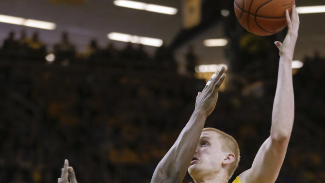 Iowa's Aaron White, right, is fouled by Wisconsin's Nigel Hayes during the second half of an NCAA college basketball game Saturday, Jan. 31, 2015, in Iowa City, Iowa. (AP Photo/Jim Slosiarek)