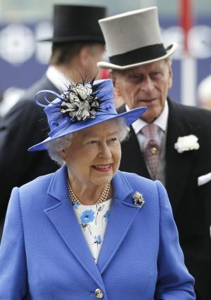 Britain's Queen Elizabeth II and Prince Philip arrive for the Epsom Derby at Epsom race course, southern England at the start of  four-day Diamond Jubilee celebrations to mark the 60th anniversary of the Queen's accession to the throne Saturday, June 2, 2012. (AP Photo/Sang Tan)