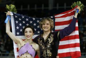 Meryl Davis and Charlie White of the U.S. celebrate with their flag during the Figure Skating Ice Dance Free Dance Program at the Sochi 2014 Winter Olympics