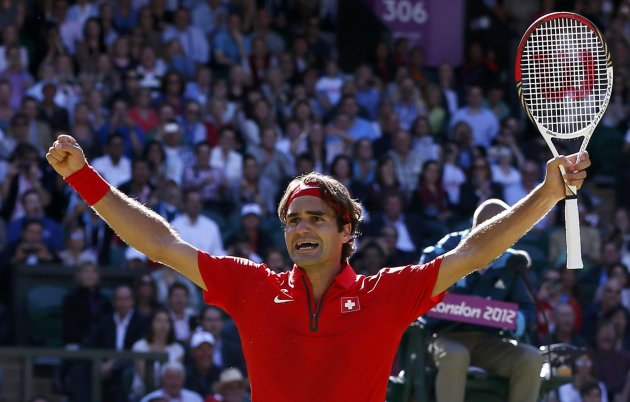 Federer celebrates after winning his men's singles tennis semi-final match against del Potro during the London 2012 Olympic Games
