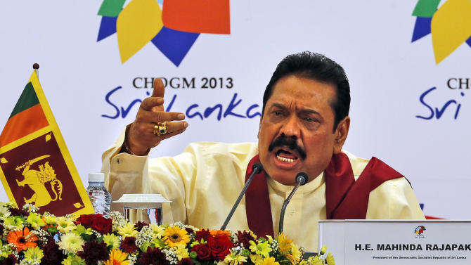 FILE - In this Nov. 17, 2013 file photo, Sri Lankan President Mahinda Rajapaksa speaks during a media briefing on the final day of the Commonwealth Heads of Governments Meeting (CHOGM) in Colombo, Sri Lanka. Rajapaksa says he will not allow a U.N. panel investigating allegations of war crimes to visit Sri Lanka. Rajapaksa told foreign journalists on Tuesday, Aug. 19, 2014 that he does not accept any investigation by the United Nations into allegations of abuses by his soldiers and the defeated Tamil Tiger rebels at the end of the country's civil war in 2009. (AP Photo/Eranga Jayawardena, File)