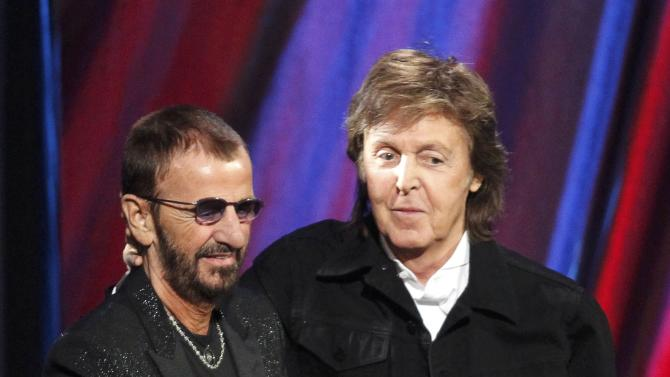 Starr stands with McCartney after McCartney inducted Starr during the 2015 Rock and Roll Hall of Fame Induction Ceremony in Cleveland