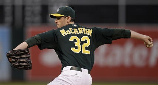 Moss gets 4 hits, 4 RBIs as A's rout Boston 20-2