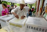 A citizen casts his vote at a polling station in San Juan, a municipality of Monterrey on election day. Voters in Mexico exhausted by drug violence looked set Sunday to return to power the Institutional Revolutionary Party (PRI) with its charismatic new leader Enrique Pena Nieto at the helm
