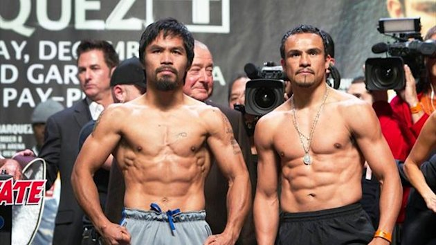 Manny Pacquiao and Juan Manuel Marquez of Mexico pose during an official weigh-in (Reuters)