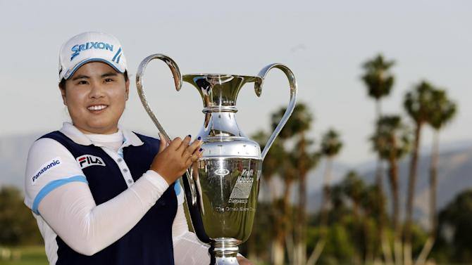 Inbee Park, of South Korea, holds up the trophy after winning the LPGA Kraft Nabisco Championship golf tournament in Rancho Mirage, Calif., Sunday, April 7, 2013. (AP Photo/Chris Carlson)