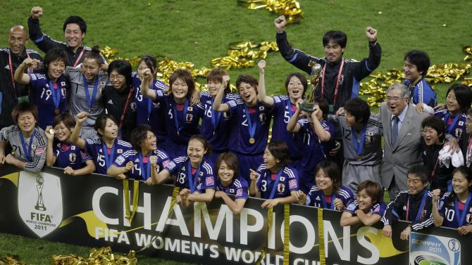 Japan players celebrate winning the final match between Japan and the United States at the Women's Soccer World Cup in Frankfurt, Germany, Sunday, July 17, 2011. The Japanese women's soccer team won their first World Cup Sunday after defeating USA in a penalty shoot-out.(AP Photo/Michael Sohn)