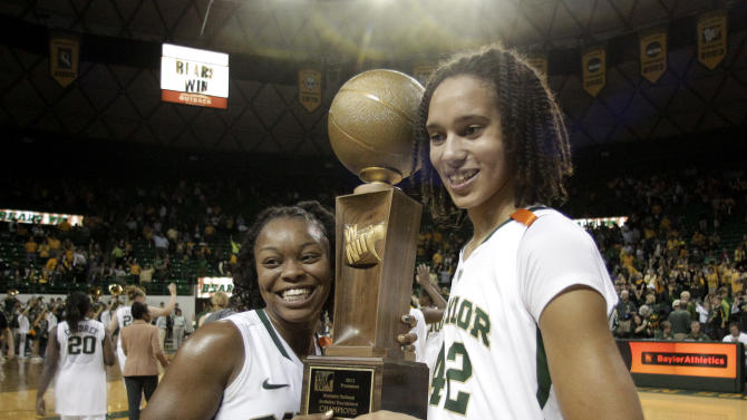 Baylor's Odyssey Sims (0) and Brittney Griner (42) pose with the WNIT Championship trophy following their 94-81 win over Notre Dame in an NCAA college basketball women's Preseason NIT game on Sunday, Nov. 20, 2011, in Waco, Texas. (AP Photo/Tony Gutierrez)