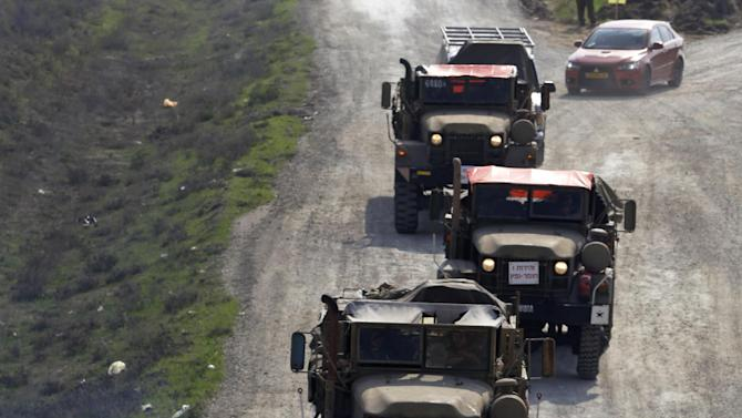 Israeli army vehicles form a convoy as they drive out of southern Israel, near the Israel Gaza Strip Border, Thursday, Nov. 22, 2012. A cease-fire agreement between Israel and the Gaza Strip's Hamas rulers took effect Wednesday night, bringing an end to eight days of the fiercest fighting in years and possibly signaling a new era of relations between the bitter enemies. (AP Photo/Lefteris Pitarakis)