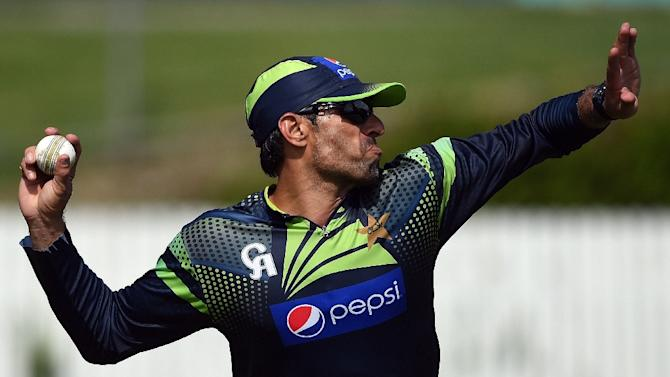 Pakistan's captain Misbah-ul Haq throws the ball during a training session at the Allan Border Fields in Brisbane, on February 26, 2015