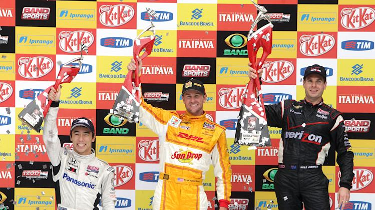 IndyCar driver Will Power of Australia, right, Ryan Hunter-Reay of the U.S., center and Takuma Sato, of Japan, celebrate their first, second and third place wins at the IndyCar's Sao Paulo 300 in Sao Paulo, Brazil, Sunday, April 29, 2012. (AP Photo/Andre Penner)