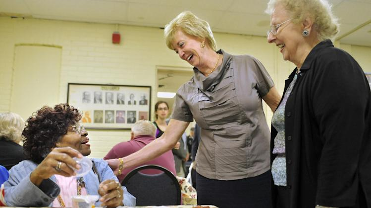 In this Tuesday, Sept. 18, 2012 photo, Republican candidate for U.S. Senate Linda McMahon talks with Cluster Hollie, left, as Ellen Manke, right, watches, during a visit to the Naugatuck Senior Center in Naugatuck, Conn. Wealthy former pro wrestling executive McMahon is shifting her image from groin-kicking CEO to grandmother in her second bid for a Senate seat from Connecticut. Polls show the strategy seems to be working against three-term Democratic congressman Chris Murphy.(AP Photo/Jessica Hill)