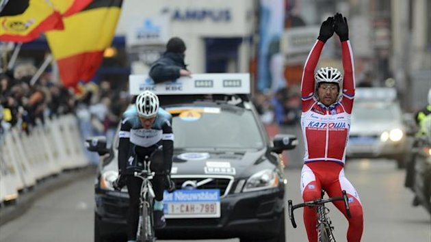 Katusha team rider Lucas Paolini of Italy celebrates as he wins the Omloop Het Nieuwsblad cycling race in Ghent February 23, 2013. (Reuters)