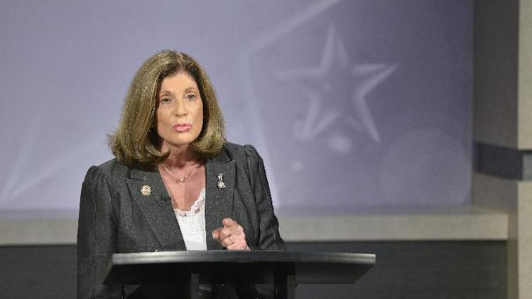 Democratic congresswoman Shelley Berkley, D-Nev., as she debates Republican Senator Dean Heller at the Reno public television studios Thursday, Sept. 27, 2012.(AP Photo/Scott Sady)