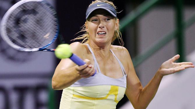 Maria Sharapova of Russia returns the ball during her match against Caroline Garcia of France on the second day of the WTA Qatar Ladies Open in Doha, Qatar, Tuesday, Feb. 12, 2013. (AP Photo/Osama Faisal)