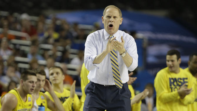 Michigan head coach John Beilein speaks to players against Syracuse during the first half of the NCAA Final Four tournament college basketball semifinal game Saturday, April 6, 2013, in Atlanta. (AP Photo/David J. Phillip)