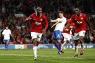 Manchester United's Ashley Young, left, celebrates after scoring a goal against FC Basel during their Champions League group C soccer match at Old Trafford, Manchester, England, Tuesday Sept. 27, 2011. (AP Photo/Jon Super)