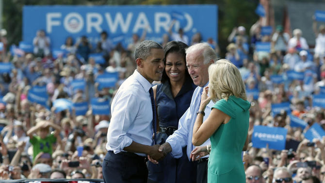 President Barack Obama and Vice President Joe Biden shake hands on stage with first lady Michelle Obama, second from left, and Jill Biden, right,  a campaign event at Strawbery Banke Field, Friday, Sept. 7, 2012, in Portsmouth, N.H. (AP Photo/Carolyn Kaster)