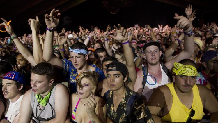 Music fans gather to hear rapper Kendrick Lamar at the Bonnaroo music festival in Manchester, Tenn., Thursday, June 7, 2012.  (AP Photo/Dave Martin)