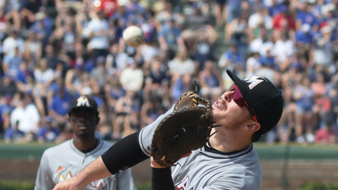 Miami Marlins first baseman Justin Bour (48) catches a fly ball hit by the Chicago Cubs' Matt Szczur during the seventh inning of a baseball game on Friday, July 3, 2015, in Chicago. (AP Photo/Andrew A. Nelles)