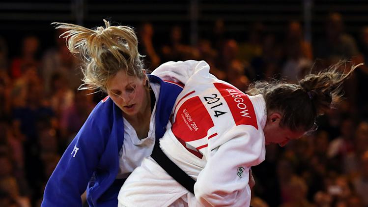 Wales' Natalie Powell, right, and England's Gemma Gibbons fight during the Women's -78kg judo gold medal bout at the Commonwealth Games 2014 in Glasgow, Scotland, Saturday July 26, 2014. (AP Photo/Scott Heppell)