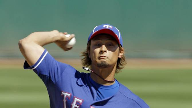 Texas Rangers' Yu Darvish, from Japan, pitches against the Cleveland Indians during the first inning of a spring training baseball game Tuesday, March 13, 2012, in Goodyear, Ariz. (AP Photo/Mark Duncan, Pool)