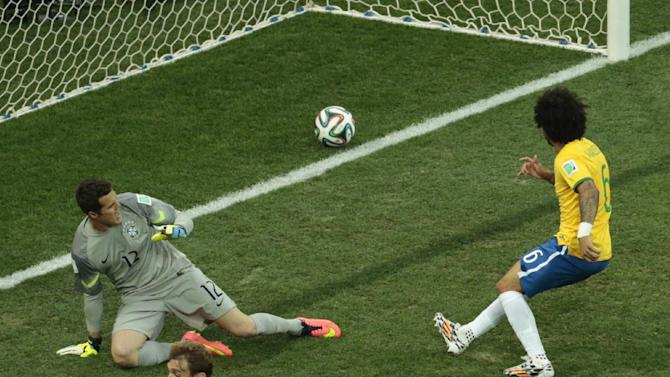 Brazil's Marcelo, right, scores an own goal during the group A World Cup soccer match between Brazil and Croatia, the opening game of the tournament, in the Itaquerao Stadium in Sao Paulo, Brazil, Thursday, June 12, 2014. (AP Photo/Shuji Kajiyama)