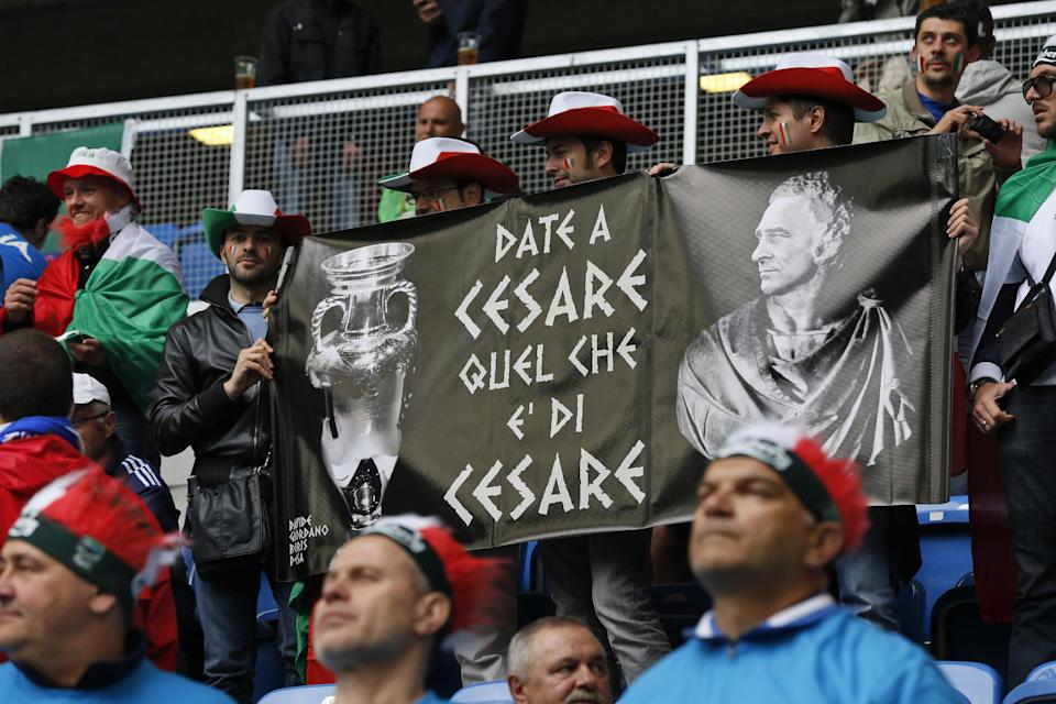 "Italian fans display a banner reading ""Give Caesar What is Caesar's""  before the Euro 2012 soccer championship Group C match between Italy and Croatia in Poznan, Poland, Thursday, June 14, 2012. (AP Photo/Gregorio Borgia)"