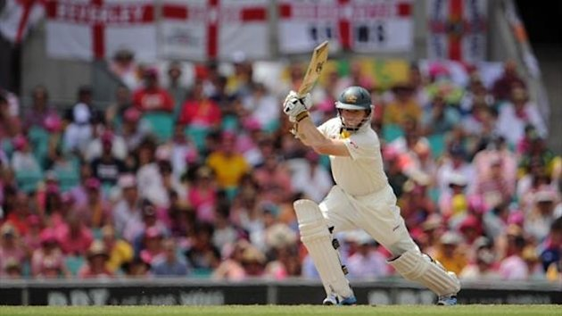 Australian batsman Chris Rogers plays a shot on the third day of the fifth Ashes Test against England (AFP)