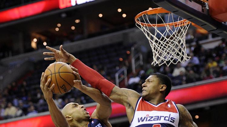 Bobcats in 6th after 94-88 OT win over Wizards