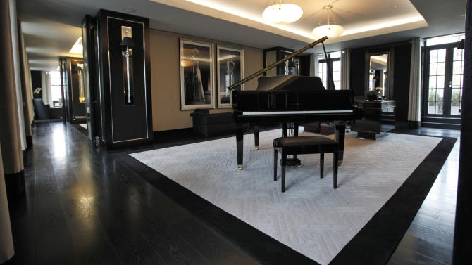 This  Friday, March, 16, 2012 photo shows a reception room with baby grand piano and large desk in one of the five bedroom luxury penthouse apartments overlooking Hyde Park, London which is available for hire during the London 2012 Olympics for some 11,000 British pounds (US$17,600) a night - and includes a maid a butler and and Aston Martin car.  Most of London's most exclusive hotels have been booked for the Olympics, snapped up by Olympic officials or companies block-booking rooms for favored customers, but there are still amazing places to stay. That is, if you can afford the bill.(AP Photo/Alastair Grant)