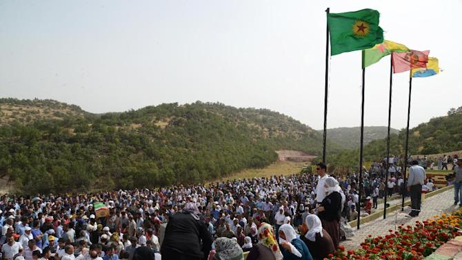 People attending the funeral ceremony of Mehdi Taskin, who died during clashes between protesters and security forces during an operation to remove a statue of Mahsum Korkmazare, one of the founders of the PKK, on August 19, 2014