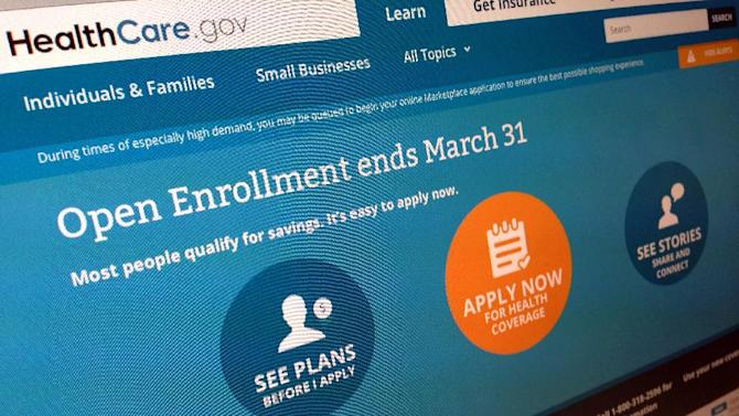FILE - This March 1, 2014 file photo shows part of the website for HealthCare.gov as photographed in Washington. Welcome news for the Obama administration: A major new survey out Monday says the U.S. uninsured rate kept dropping last month and it's now on track to reach the lowest levels since 2008, before President Barack Obama took office. The Gallup-Healthways Well-Being Index finds that 15.9 percent of Americans lack health insurance so far in 2014, down from 17.1 percent in the last three months of 2013. Gallup interviewed more than 28,000 adults, making the results highly accurate. (AP Photo/Jon Elswick, File)