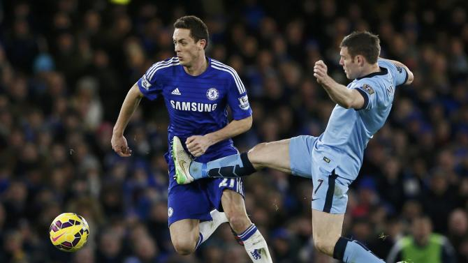 Chelsea's Nemanja Matic is challenged by Manchester City's James Milner during their English Premier League soccer match at Stamford Bridge in London