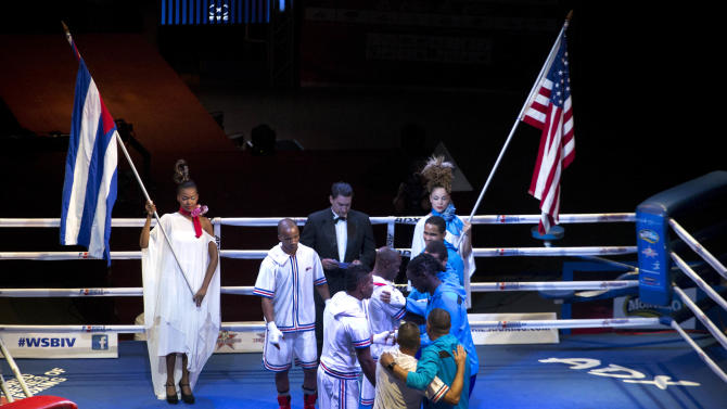 Cuban and U.S. boxers greet each other before the start of competition in Havana, Cuba, Friday, April. 4, 2014. Boxers from the U.S. and Cuba went glove-to-glove on Cuban soil for the first time in 27 years Friday in a semipro World Series of Boxing clash. (AP Photo/Ramon Espinosa)