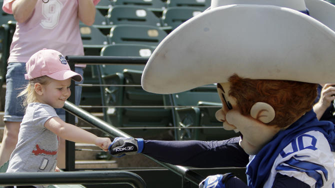 Dallas Cowboys mascot Rowdey fist bumps with a young girl before the start of the Home Run Derby Competition hosted by Reliant to benefit The Salvation Army on Wednesday, May 8, 2013 in Arlington, Texas. A total of $43,000 was raised for the charity. (Brandon Wade/AP Images for Reliant)