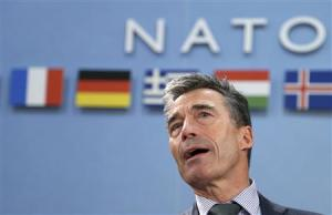 Rasmussen looks on during a NATO foreign ministers meeting at the Alliance headquarters in Brussels