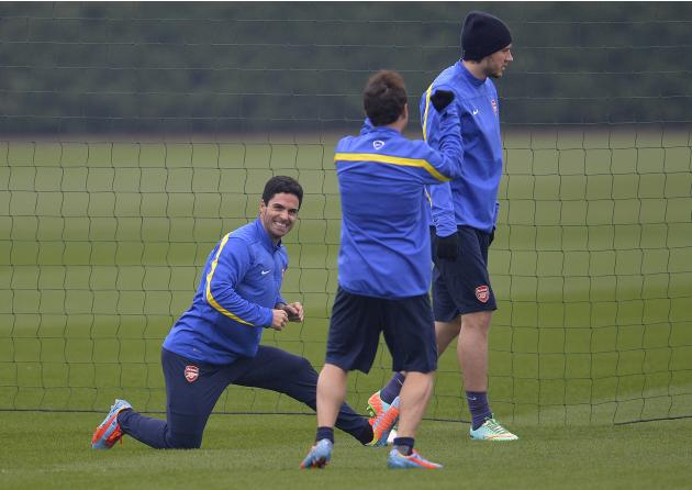 Arsenal's Mikel Arteta stretches during a training session at London Colney near London