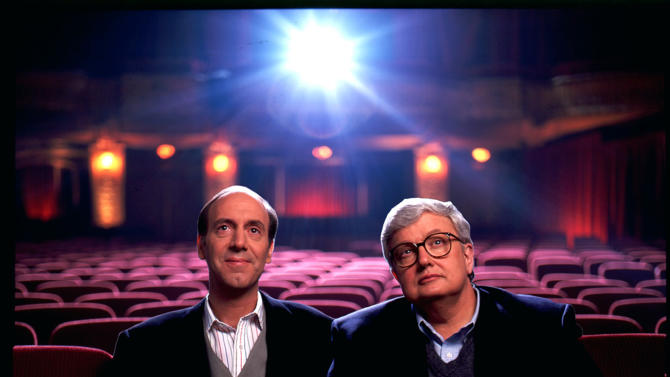 """FILE - This undated file photo originally released by Disney-ABC Domestic Television, shows movie critics Roger Ebert, right, and Gene Siskel. The Chicago Sun-Times is reporting that its film critic Roger Ebert died on Thursday, April 4, 2013. He was 70. Ebert and Siskel, who died in 1999, trademarked the """"two thumbs up"""" phrase.   (AP Photo/Disney-ABC Domestic Television)"""