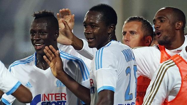 Olympique Marseille's Benjamin Mendy (L) reacts with teammates after scoring against Saint Etienne during their French Ligue 1 soccer match at the Velodrome stadium in Marseille, September 24, 2013. (Reuters)