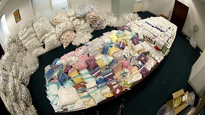 In this undated photo provided by the Federal Bureau of Investigation, a large supply of vials, pills and other medical supplies seized by the FBI in a drug diversion scheme are shown in the FBI's evidence room in New York. Prosecutors say that the scheme cheated Medicaid out of hundreds of millions of dollars by buying mountains of HIV medications and other drugs from down-and-out Medicaid recipients in New York City, then marketing the pills to pharmacies that dispensed them to unsuspecting consumers, authorities said Tuesday, July 17, 2012. (AP Photo/FBI, Matthew Coleman)