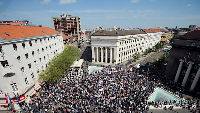 People take part in a protest organized by Udruga Franak in front of Croatian National Bank in Zagreb