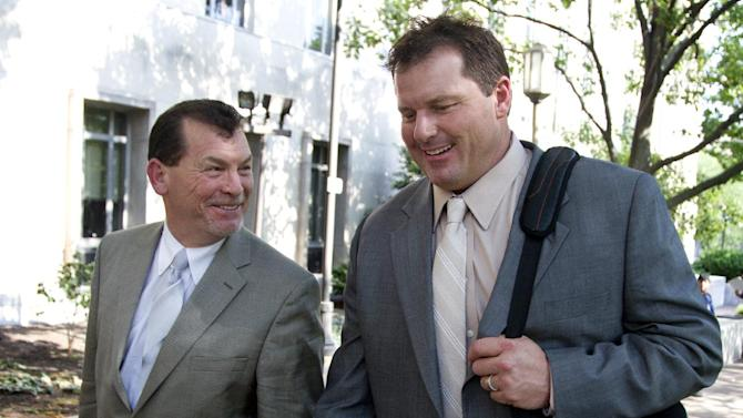 Former Major League Baseball pitcher Roger Clemens, right, with a member of his legal team, leaves federal court in Washington, Friday, May 25, 2012. A forensic scientist testified Friday that two cotton balls and a syringe needle allegedly saved after a steroids injection, tested positive for Roger Clemens' DNA, a key moment as the government tries to prove the former pitcher used performance-enhancing drugs. (AP Photo/Manuel Balce Ceneta)