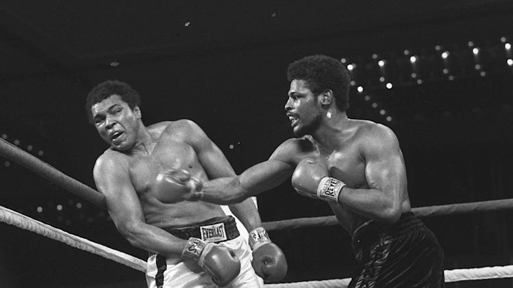"""FILE - Leon Spinks connects with a right hook to Muhammad Ali, in this Feb.16, 1978 file photo taken during the late rounds of their championship fight in Las Vegas, Nev. The 24-year-old Spinks won the bout in a 15-round decision. Muhammad Ali lost just twice in his seven prizefights in Las Vegas over 19 years. Now, dozens of heavyweight celebrities are back in Sin City to laud a lifetime in the spotlight and join the icon known as """"The Greatest"""" in fighting neurological diseases. (AP Photo, File)"""