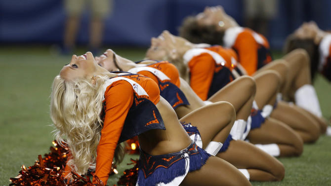 The Denver Broncos cheerleaders perform during the second half of an NFL preseason football game against the Houston Texans, Saturday, Aug. 23, 2014, in Denver. (AP Photo/Brennan Linsley)