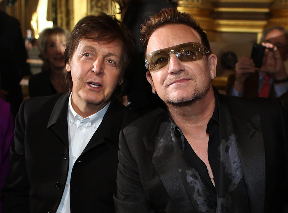 Sir Paul McCartney and Bono pose for photographers prior to fashion designer Stella McCartney's Fall/Winter 2013-2014 ready to wear collection, in Paris, Monday, March, 4, 2013. (AP Photo/Thibault Camus)