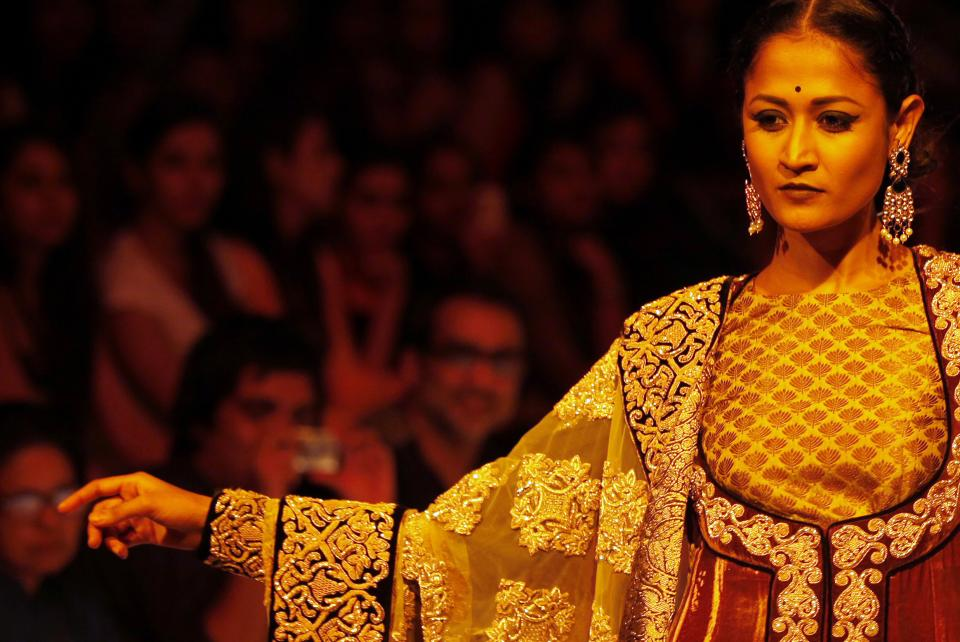 An Indian model displays a creation by Shyamal and Bhumika during the Lakme Fashion Week in Mumbai, India, Monday, Aug. 6, 2012. (AP Photo/Rajanish Kakade)