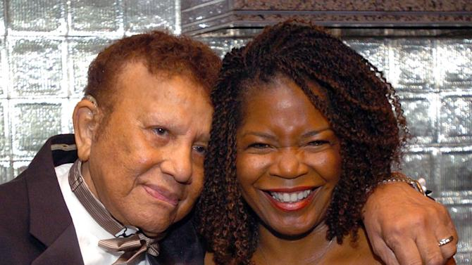 "FILE- In this Nov. 3, 2004 file photo, Harold ""Hal"" Jackson and wife Debi share a moment before celebrating Jackson's 65 years of broadcasting at a benefit for the Youth Development Foundation, at the Rainbow Room in New York. Jackson, who was the first African-American voice on network radio, died Wednesday, May 23, 2012. He was in his late 90s.  (AP Photo/Gina Gayle, File)"