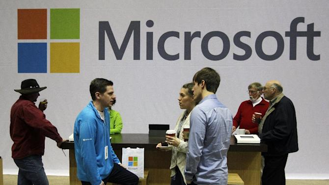Microsoft Corp. retail store employees and guests mingle at a pop-up Microsoft Store during Microsoft's annual meeting of shareholders, Wednesday, Nov. 28, 2012, in Bellevue, Wash. (AP Photo/Ted S. Warren)