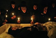 Nuns mourning next to the coffin of Irina Cornici at Tanacu monastery, in Tanacu, in 2005. Palme d'Or winner Cristian Mungiu is back in Cannes this week with a film based on the deadly exorcism that ended in Cornici's death in Romania - but Mungiu's film runs far deeper than the shock case, says the author who inspired him